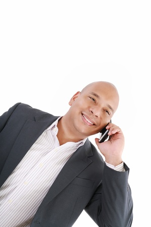 Business man talking on cell phone. Pleasant Look. One White. Business Casual Look photo