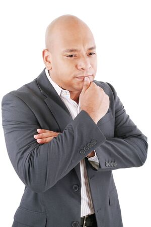 pensador: Pensando hombre de negocios en un traje aisladas sobre fondo blanco Foto de archivo