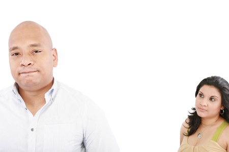 heartbreak issues: young couple on white background having a dispute. Focus on man