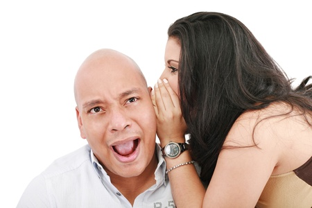 Closeup portrait of a cute young woman whispering in her husband ear  photo