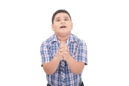 crying boy: Shocked 10 year old boy trying to defend himself isolated on white