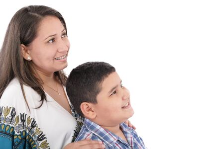 mom kiss son: Happy mother with orthodontics and son isolated on light background