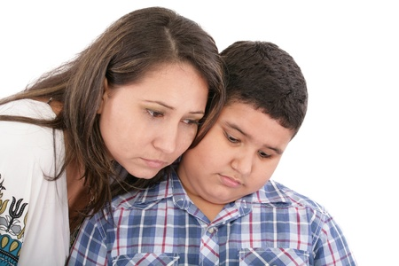 consoling: Mother comforting her son  Stock Photo