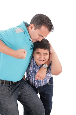 abusive man: Young boy being aggressively held up by his father