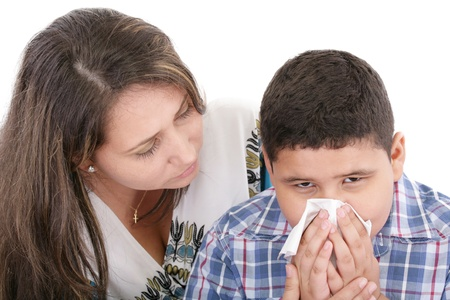 hankie: Child blowing nose. Child with tissue. catarrh or allergy  Stock Photo