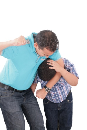 impish: Young kid about to be thumped by father  Stock Photo