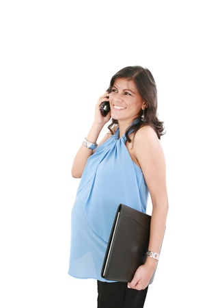 Site view of a beautiful pregnant woman talking on a phone, isolated on a white background.  photo