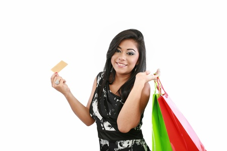 Young woman with shopping bags and credit card on a white background  Stock Photo - 16305884
