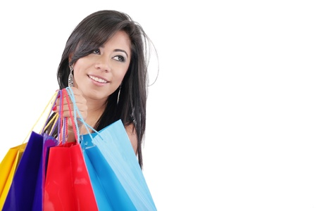 Portrait of a beautiful woman with colored shopping bags isolated on white Stock Photo - 16305885