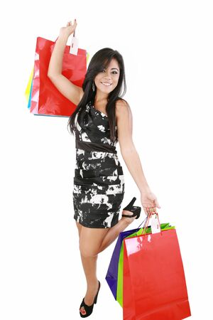 Shopping woman happy smiling holding shopping bags isolated on white background. Stock Photo - 16305892