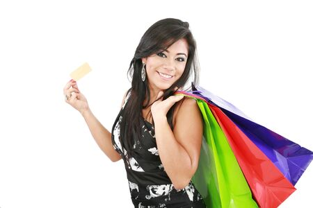 Young woman with shopping bags and credit card on a white background  Stock Photo - 16305893