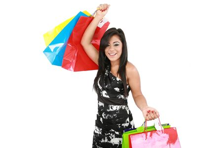 Young woman with shopping bags over white background Stock Photo - 16305889