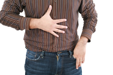 ulcer: man holding his stomach in pain or indigestion