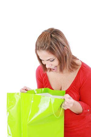 opened bag: surprised brunette woman holding opened shopping bag