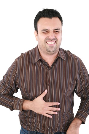 flatulence: Young man suffering from a bad stomach ache pain isolated on white background  Stock Photo