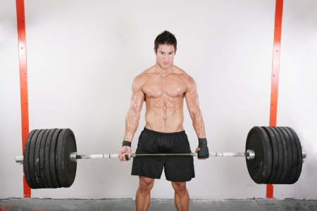 barbel: bodybuilder training in a gym   Stock Photo