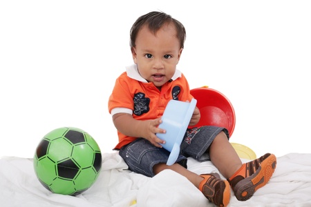 One year old baby boy enjoys playing with toys. Studio Shot. Stock Photo - 16619179