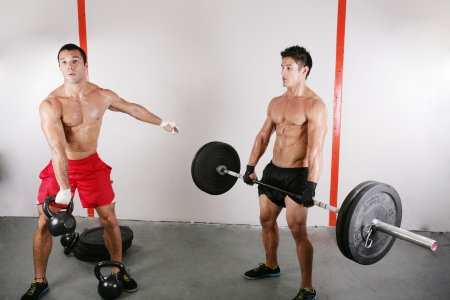 crossfit: group with dumbbell weight and kettlebell training equipment on sport gym