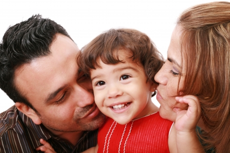 Parents giving their daughter a kiss.
