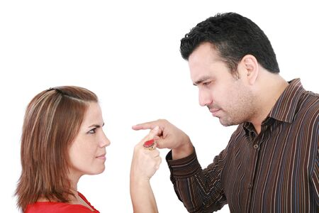 disagree: Young couple pointing at each other against a white background   Stock Photo