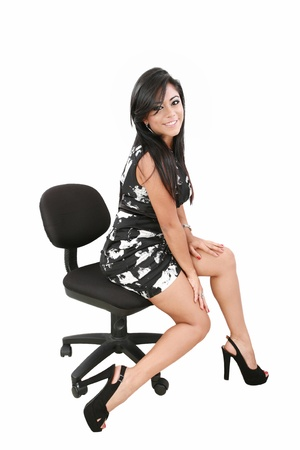 young woman sitting on a chair isolated over white background  photo