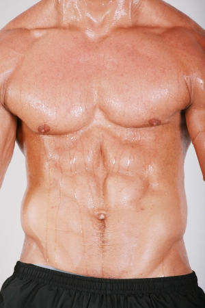 Muscular and tanned male naked torso Stock Photo - 16711154