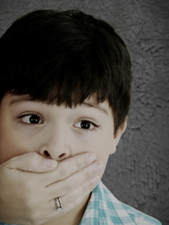 Scared 8 year old boy being abused or abducted by adult female. Stock Photo - 16873543