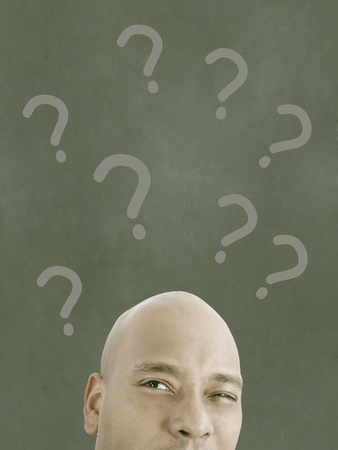 man with questions symbol overhead  Stock Photo - 16873542