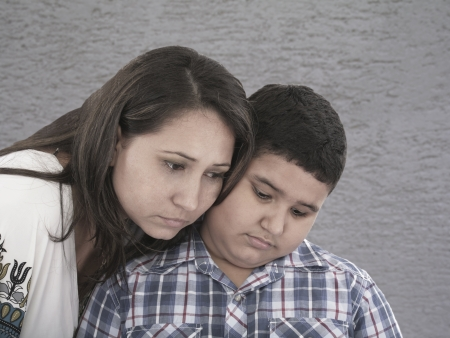 mother and son with sad expression