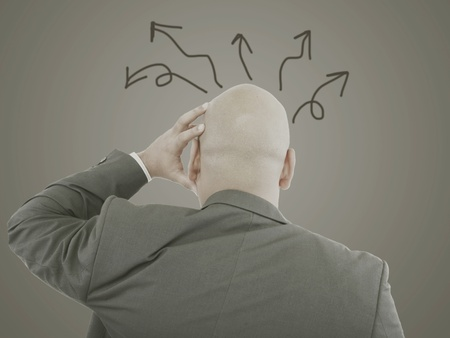 Worried businessman with arrows in different directions Stock Photo - 16873539