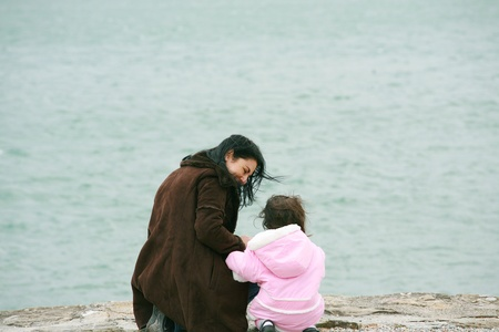 Back view of mother and daughter in beautiful spring sea Stock Photo - 16986561