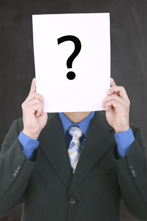 Young businessman holding a white billboard with a question mark on it Stock Photo - 16960267