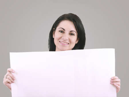 Beautiful woman with a banner smiling Stock Photo - 17054512
