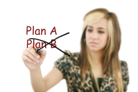 Woman crossing over Plan A, writing Plan B. Stock Photo - 17054510