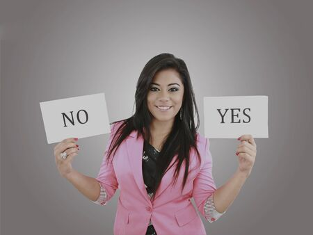 Business young woman trying to make a decision between Yes or No choice Stock Photo - 17054514