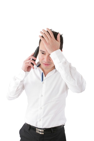 freaked: Young handsome businessman talking at the cell phone