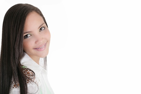 Cute Latina teenage girl smiling with braces on a white background