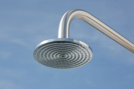 shower head: close up on head shower in a blue sky
