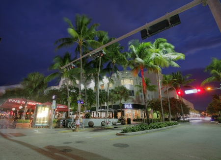 MIAMI, FL - JAN 31: Lincoln Road, pedestrian road running east-west between 16th Street and 17th Street on Jan 31, 2013 in Miami Beach, Florida, USA. Once open to vehicular traffic, it now hosts a pedestrian row of shops, restaurants, galleries, and other