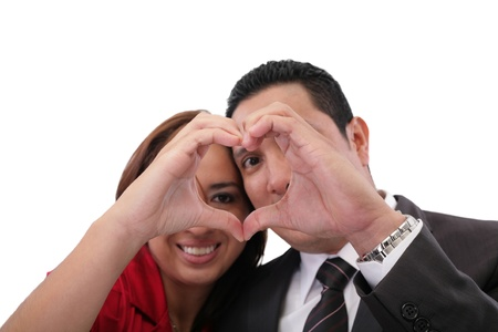 Happy couple in love showing heart with their fingers Stock Photo - 18410524