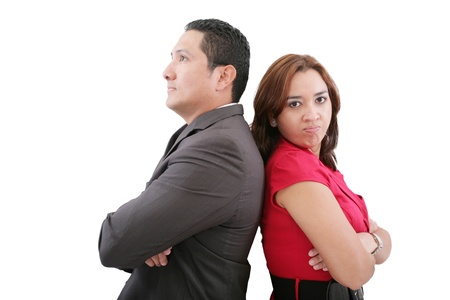 Young couple standing back to back having relationship difficulties on white background  photo