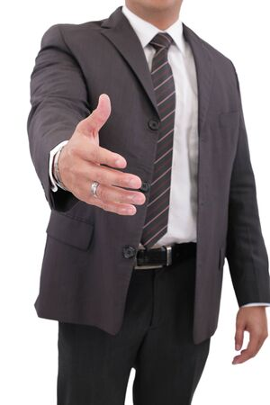 handshaking: Business man with hand extended to handshake - isolated over white