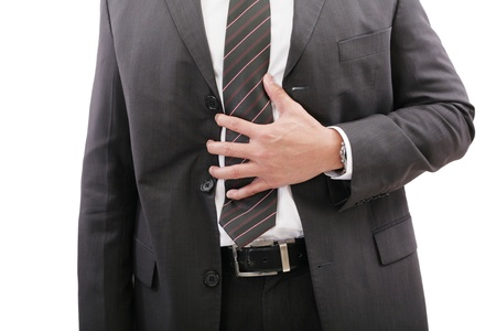 indigestion: Businessman holding his stomach in pain or indigestion
