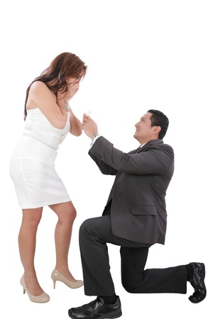 young man down on his knee proposing to girlfriend  photo