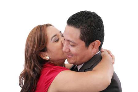 cheek: Young woman kissing her Boyfriend