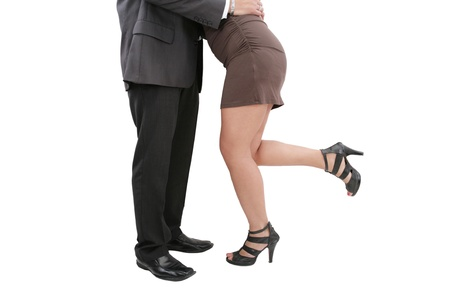 seducing: A young manager seducing his secretary or colleague  Stock Photo