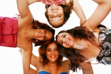 ange: Group of happy women standing in huddle, smiling, low ange view. Stock Photo