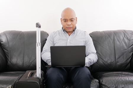 african travel businessman working in airport vip lounge photo