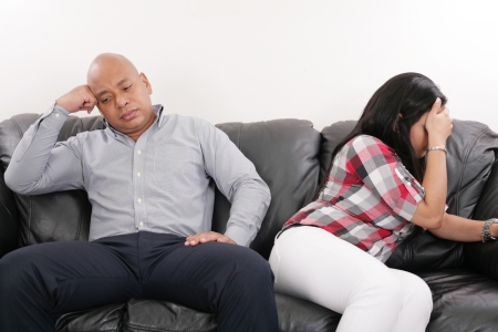 argument from love: Young Couple on the Sofa after Quarrel  Stock Photo