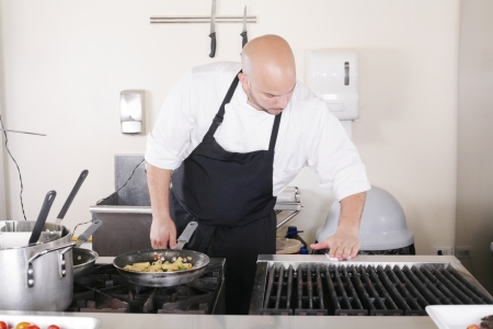 clean commercial: professional chef cleaning the kitchen